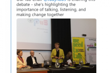 """Tweet: @HWSheffield """"Our fab Chair @JudyRob9 is chairing this debate - she's highlighting the importance of talking, listening, and making change together"""". Embedded photo of Judy welcoming the audience to the event"""