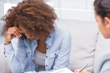 A woman talking to a therapist