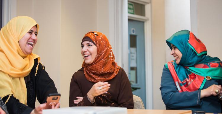 3 seated Muslim Women