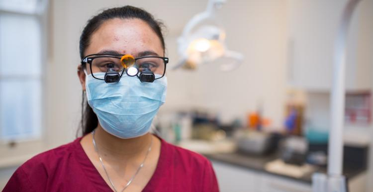 Dentist with special glasses