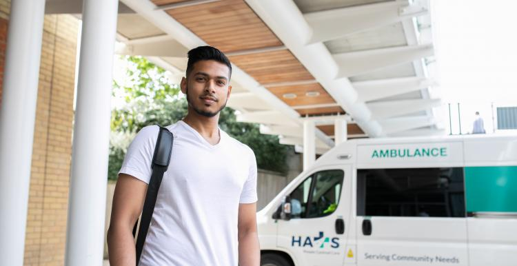 Young man in hospital car park