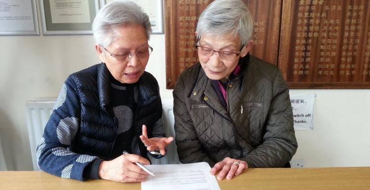 Filling in surveys at the Sheffield Chinese Community Centre