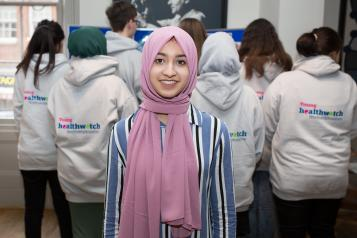 Young volunteer wearing a headscarf