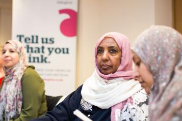 3 women sitting around a table at a Healthwatch event