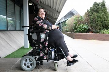 Woman in electric wheelchair smiling