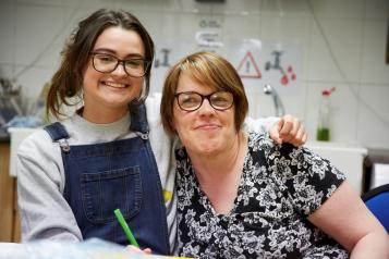 2 people smiling at Sheffield Mencap and Gateway