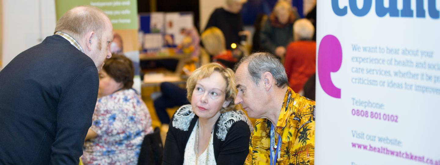 A member of the public visiting a stall at a Healthwatch event