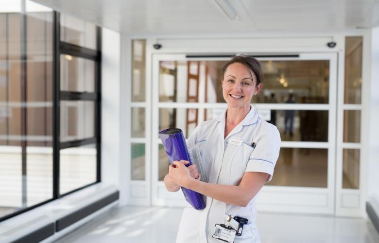 A nurse standing in a hospital corridor