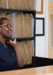 GP receptionist making a phone call