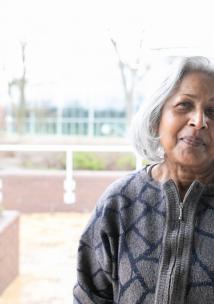 Elderly woman standing outside